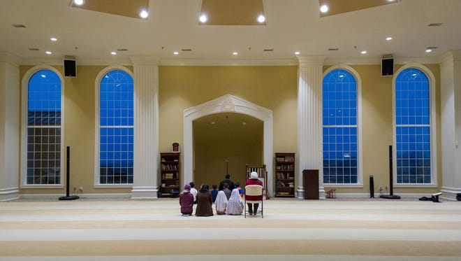 People take part in an evening prayer service Nov. 30, 2015, at the Islamic Center of Evansville in Newburgh, Ind.