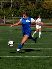 Mary Englert (25) of Madeira delivers a free kick for
