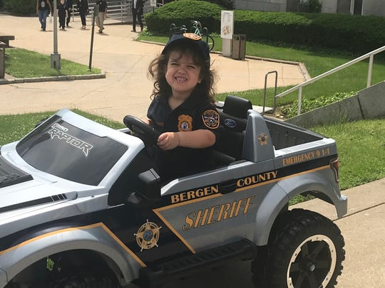 Alexandra Theodorakos, 6, tries out the Bergen County Sheriff's car during Bergen County's 7th annual Police Chief for a Day program.