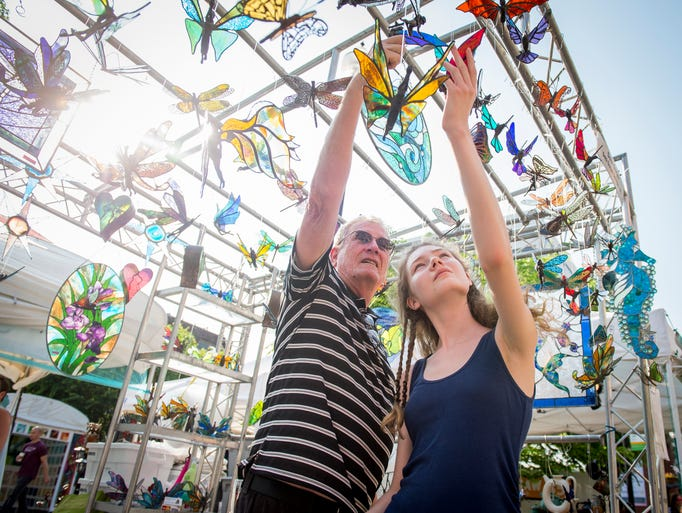 Festival goers browse the art at the Debi Dwyer Design