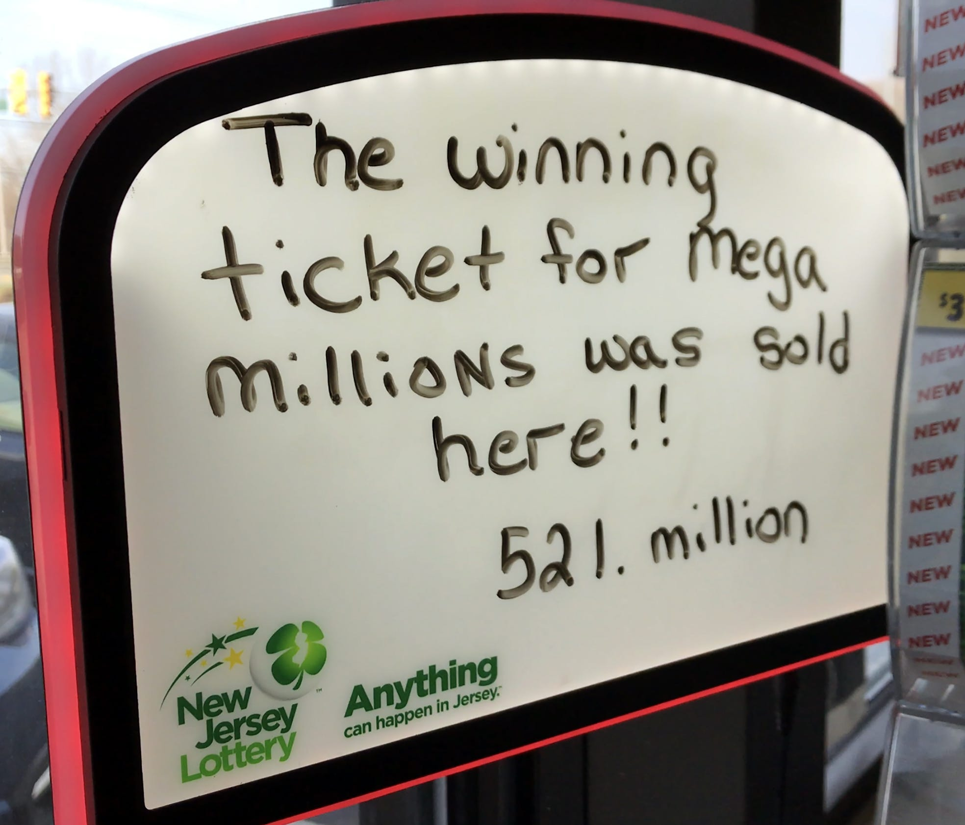 In a message photographed April 1, 2018, the owner of the Lukoil gas station and mini-mart on New Jersey 23 in Riverdale, N.J., is hoping lottery customers will think the store's Mega Millions luck will rub off on them.