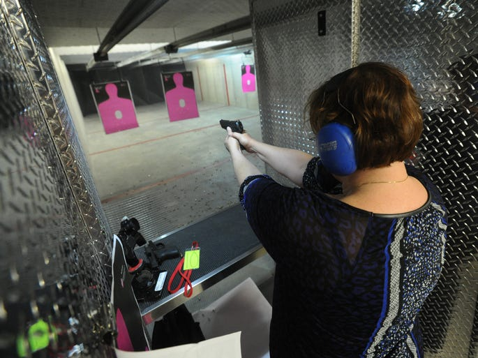 Laurie Spear of Westfield shoots a handgun during a meeting of The Well Armed Woman chapter at Tim's Shooting Academy in Westfield. All the instruction in the nationwide program is focused on armed self defense for women.