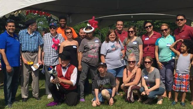 Union County Freeholder Chairman Sergio Granados (far left) joined the festivities at the annual Carnival for People with Special Needs last summer.