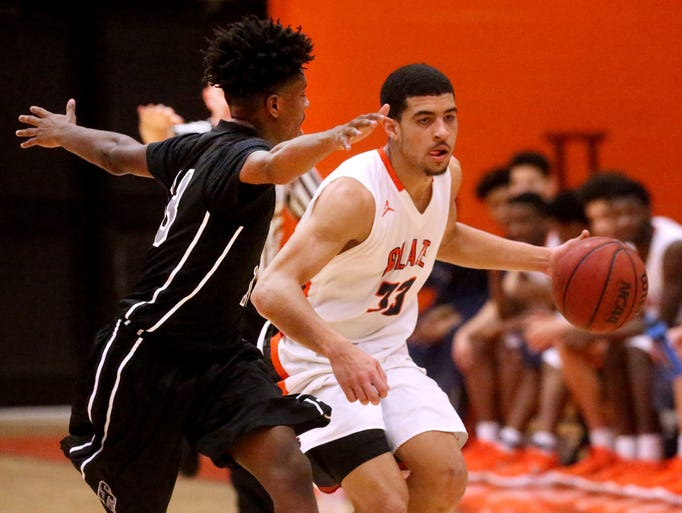Blackman's Trent Gibson (33) brings the ball up the