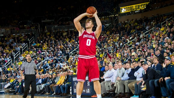 Indiana forward Max Bielfeldt (0) attempts a three-pointer in the first half of an NCAA college basketball game against Michigan at Crisler Center in Ann Arbor, Mich., Feb. 2, 2016.