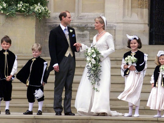 Prince Edward with his wife, Sophie Rhys-Jones, with her pageboys and bridesmaids as they leave St. George's Chapel at Windsor Castle in June 1999.