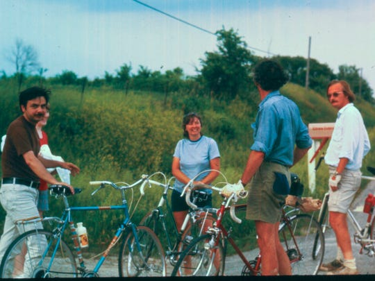 John Karras and Donald Kaul bike from Des Moines to Iowa City in 1971 — two years before they founded The Register's Annual Great Bicycle Ride Across Iowa (RAGBRAI). From left, George Anthan, an unnamed woman, Ann Karras, Karras and Kaul stop along the road outside of Iowa City.