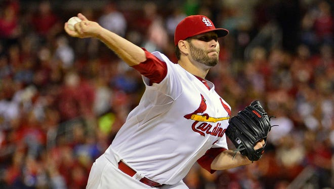 St. Louis Cardinals starting pitcher Lance Lynn (31) throws to a Los Angeles Dodgers batter during the seventh inning at Busch Stadium, July 18, 2014.