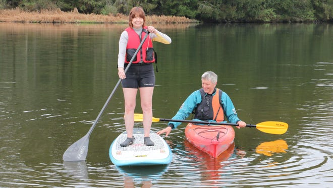 Deb Dom is shown on her standup paddleboard and Mike Seidel in a kayak. Both are volunteers with the Mansfield University Kayak Club and will be assisting people of all ages interested in trying out paddleboards, kayaks and canoes during Springfest on Saturday.