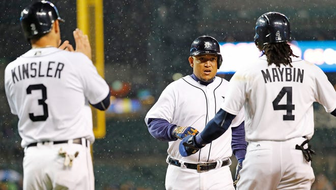 Tigers' Miguel Cabrera, center, celebrates with teammates Ian Kinsler and Cameron Maybin after hitting a three-run home run in the fifth inning against the Cleveland Indians on Sept. 28, 2016 at Comerica Park in Detroit.