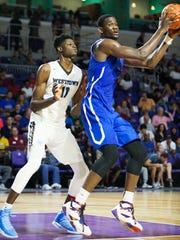 Westtown High School's Mohamed Bamba, left, defends Hillcrest Prep's DeAndre Ayton during play Sunday at the Culligan City of Palms Classic at the Suncoast Credit Union Arena in Fort Myers.
