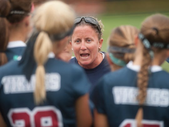 Eastern field hockey coach Danyle Heilig talks to her players during a game in 2014. Heilig stepped down as Vikings head coach after 21 seasons - all that produced state championships