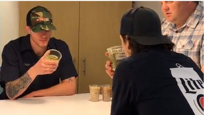 Josh Hader (left) and Taylor Williams consider hops options while creating their own beer at Miller Brewery on May 7.