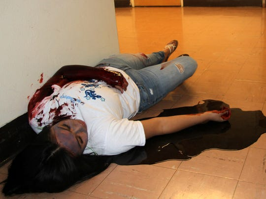 A victim lies in a hallway at Pate Elementary during the exercise.