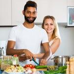 Couple preparing dinner.