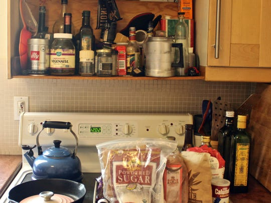 "Cooking oils, spices and other ingredients decorate a kitchen cabinet at Stephen Lee's home in Palm Springs. One of the three finalists of FOX's ""MasterChef,"" Lee will be on television on Wednesday for the show's season finale."