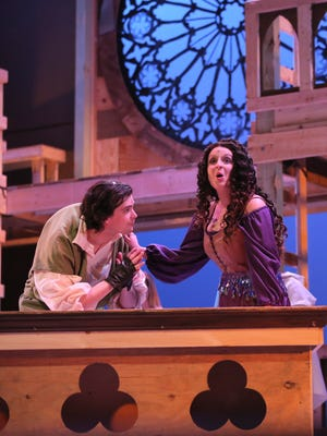 Ryan Shreve plays Quasimodo and Maddie Beer portrays Esmeralda during a rehearsal for The Hunchback of Notre Dame at the Renaissance Theatre.