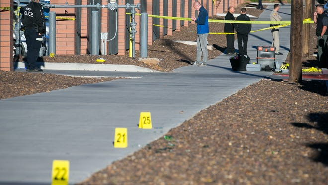 The sidewalk  near Mountain View Hall is roped off on Oct. 9 as police continue their investigation of the shooting. The incident happened on the northeast corner of the NAU campus.