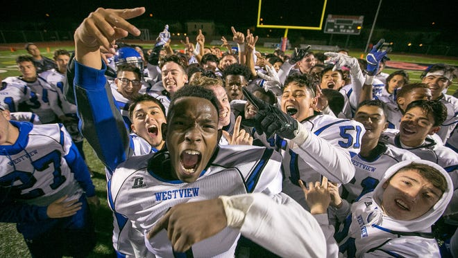 Avondale Westview players celebrate their high school football playoffs game win against Gilbert Williams Field in Gilbert on Friday, November 13, 2015.