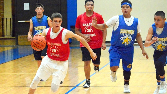 Loving's Alex Gonzalez darts toward the basket against Jal Wednesday at Carlsbad.