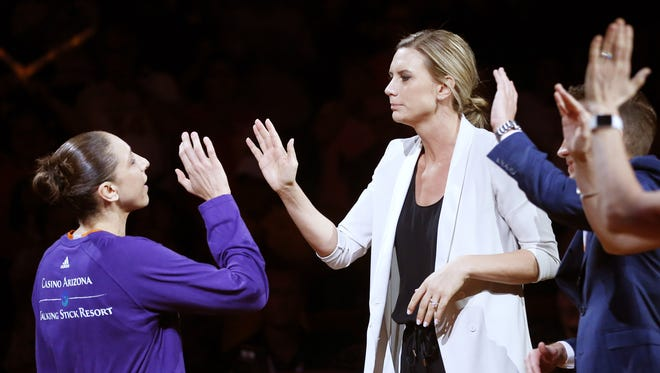 Phoenix Mercury guard Diana Taurasi (left) high-fives Penny Taylor, director of player development/performance, before playing against the Dallas Wings at Talking Stick Resort Arena in Phoenix, Ariz. May 14, 2017.