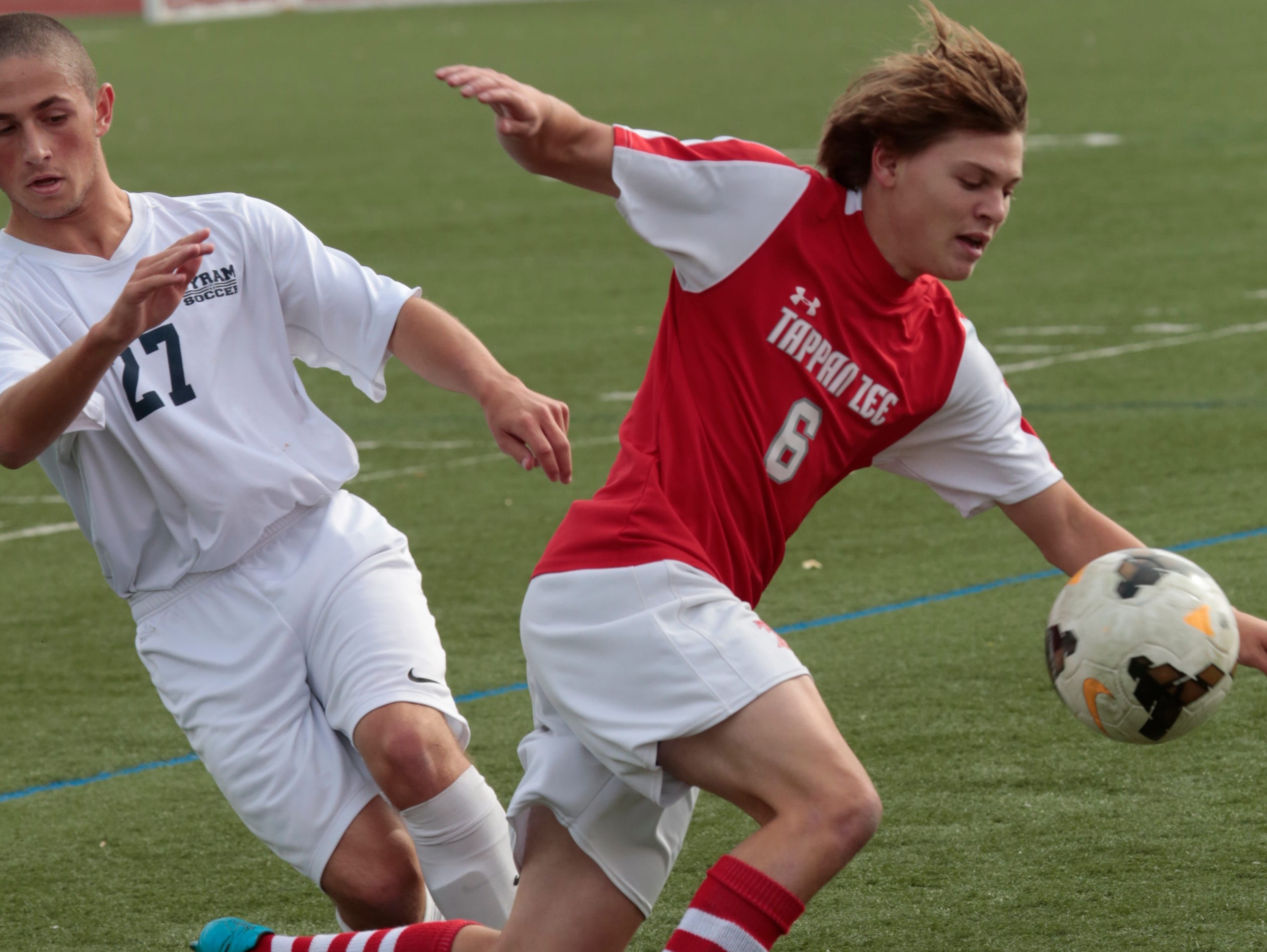 Byrum Hills Michael Bordash (27) and Tappan Zee's Mike Dalisera (6) battle for possession during the game at Byrum Hills High School in Armonk on Oct. 29, 2015.