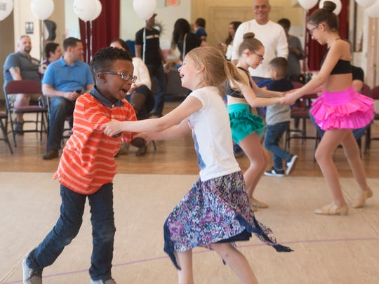 "Chase Merriweather, 6, of Sicklerville, left, who required a quadruple amputation a few years ago after contracting a near deadly strain of the flu and going into septic shock, dances with his friend Hailey Perkins, 6 of Pine Hill, during the  ""I Dance to the Beat of my Big Dreams"" 2016 Dance-A-Thon at Monarch School of Dance at Perkins Center for the Arts in Collingswood on Saturday."