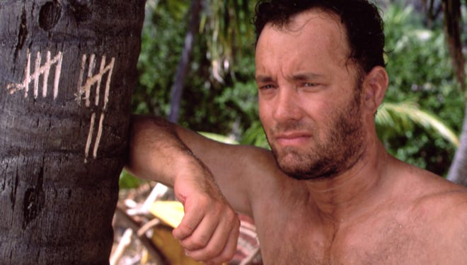 """Tom Hanks is forced to find a new way of life while stranded on a desert island in """"Cast Away."""""""