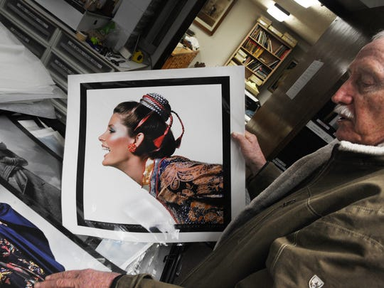 """Fashion photographer Neal Barr looks through his work for an exhibit titled """"High Style: The Photography of Neal Barr,"""" which opens Jan. 13 at the Museum of Ventura County."""