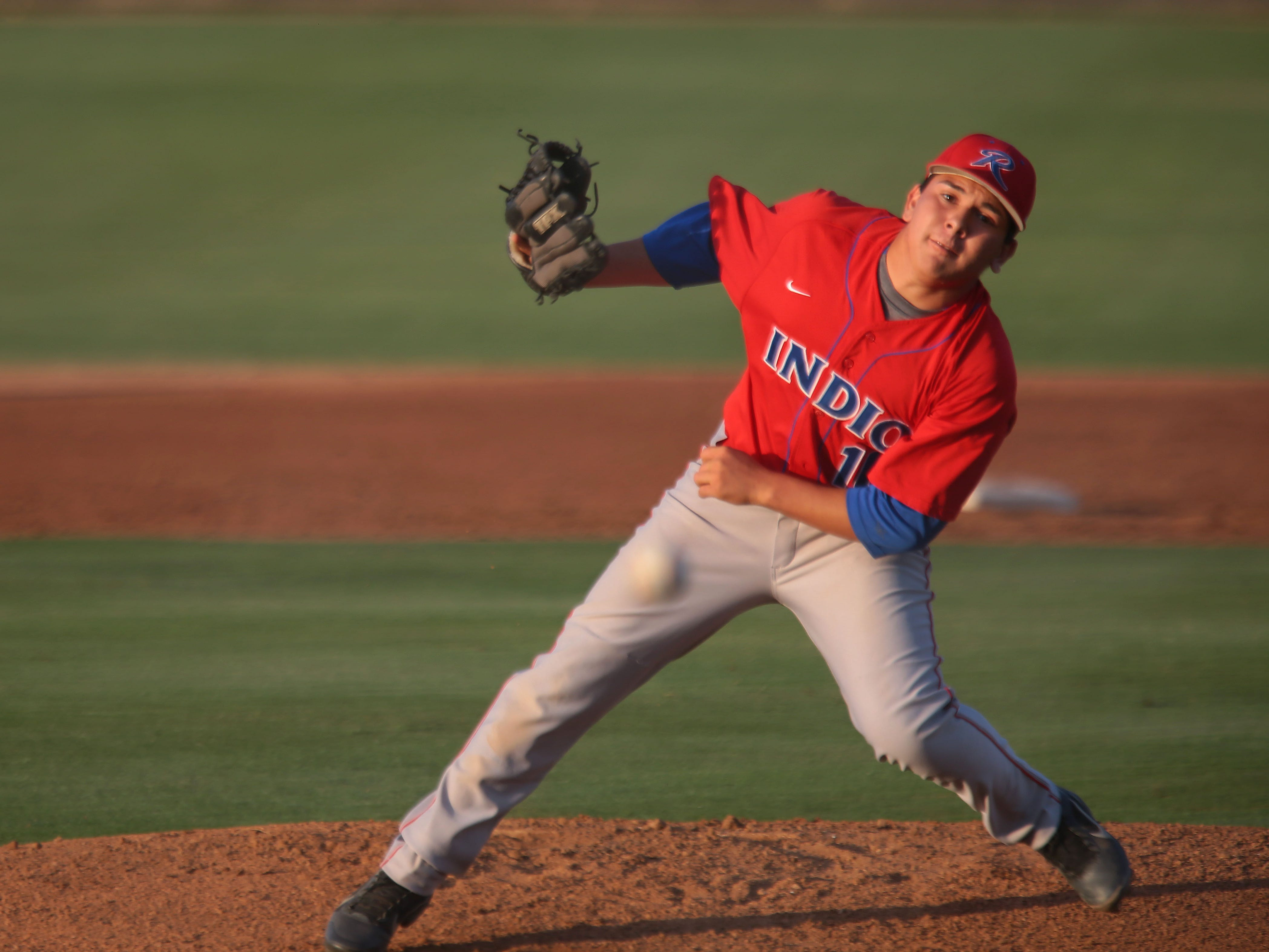 Indio's Juan Siqueiros pitches against Palm Desert on Tuesday in Palm Desert.