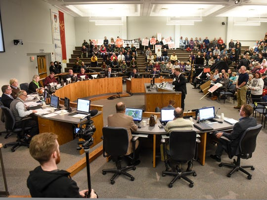 A large crowd watches as the St. Cloud City Council meeting begins Monday, Nov. 6, at City Hall.
