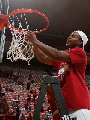 Mar 6, 2016; Bloomington, IN, USA; Indiana Hoosiers guard Yogi Ferrell (11) cuts down the net to celebrate the 2016 Big Ten championship after defeating the Maryland Terrapins at Assembly Hall. Indiana defeats Maryland 80-62. Mandatory Credit: Brian Spurlock-USA TODAY Sports