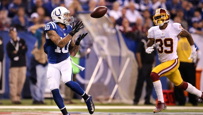 Indianapolis Colts wide receiver Donte Moncrief (10) catches a 48-yard touchdown pass as he burns Washington Redskins cornerback David Amerson (39) in the third quarter.Indianapolis Colts defeated the Washington Redskins 49-27 Sunday, November 30, 2014, afternoon at Lucas Oil Stadium.