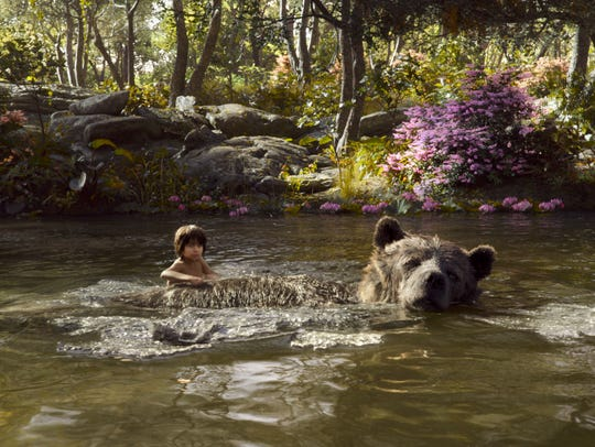 Mowgli (Neel Sethi) and the bear Baloo (voiced by Bill