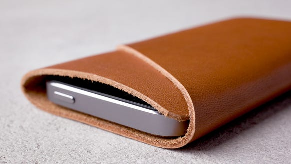 Sim fit iPhone wallet by Mujjo