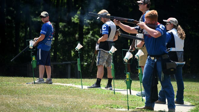 The number one squad of the Dundee Viking trap team, (right to left) 2020 graduate Dennis Root, senior Megan Marion, 2020 graduate James Root, senior Hunter Carlson, and junior Mason Nagle start shooting their first round competing in the Virtual National Shoot.