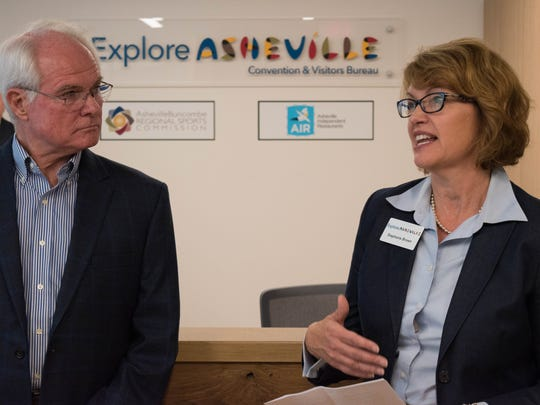 Explore Asheville President and CEO Stephanie Brown (left) at the organization's new offices at 27 College Place in the Asheville Executive Office Park in downtown Asheville.