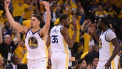 Golden State Warriors guard Klay Thompson (11) celebrates
