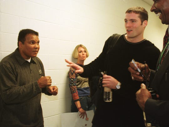 Muhammad Ali jokes with an Pacer Austin Croshere in