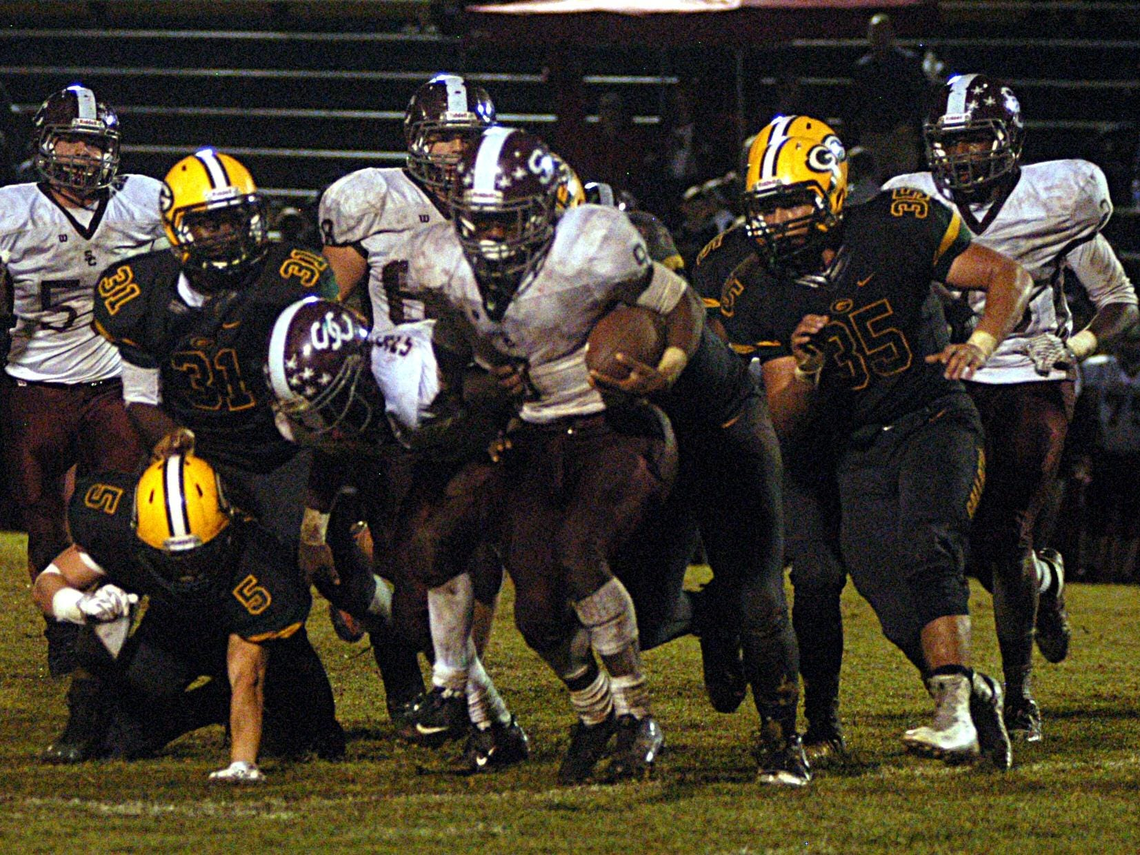 Station Camp sophomore tailback Sirtavious Perry fights for extra yardage during the third quarter of Friday's game at Gallatin. Perry scored two touchdowns in the Bison's 27-19 victory.