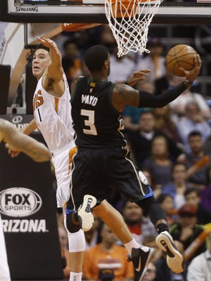 Suns' Devin Booker (1) tries to block a layup from Bucks' OJ Mayo (3) in the second half at Talking Stick Arena on Dec. 20, 2015 in Phoenix, Ariz.