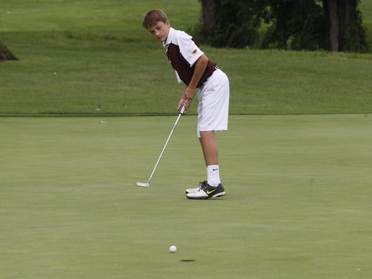 Ankeny's Thomas Nygren attempts a putt on the No. 9 hole during last year's Indianola Invitational at the Indianola Country Club. Nygren is one of the top returning players for the Hawks. He posted an average score of 45.0 strokes last year.