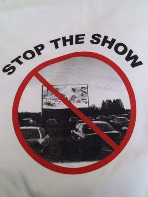 """Opponents of a proposed drive-in in Crestwood in Oldham County have printed t-shirts reading """"Stop the Show."""""""