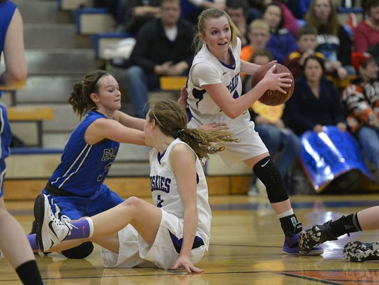Albany's Sidney Schiffler (24) emerges after a battle