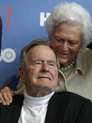 AP President George H.W. Bush and his wife Barbara