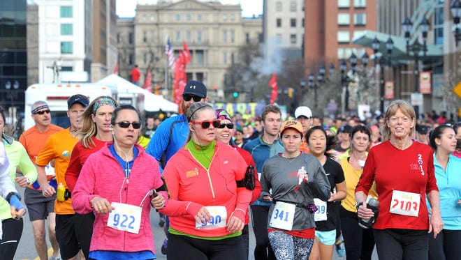 Nearly 1,900 runners participate in the Lansing Marathon.