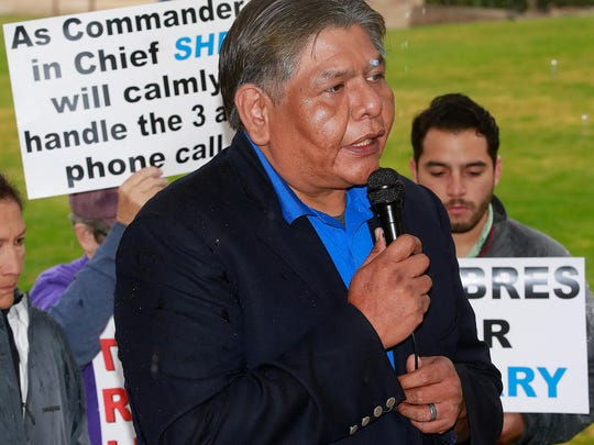 Henry Silentman, chairman of the San Juan County Democratic Party, speaks at a press conference Friday at Colinas del Norte Park before Donald Trump Jr.'s visit to Farmington.