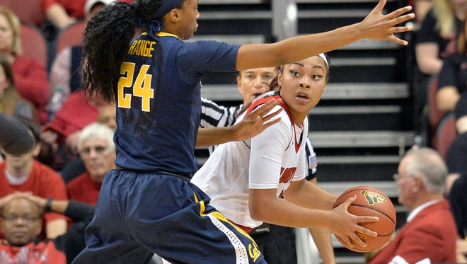 Mariya Moore, right, is one of the top scorers for Louisville, which enters Thursday's game against MSU 1-4.