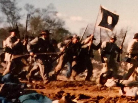 Dr. Frank McCutcheon, Jr., second from left, was once an active Civil War re-enactor, here representing the Patrick Cleburne Brigade at a 1998 event in Gettysburg, Pennsylvania.