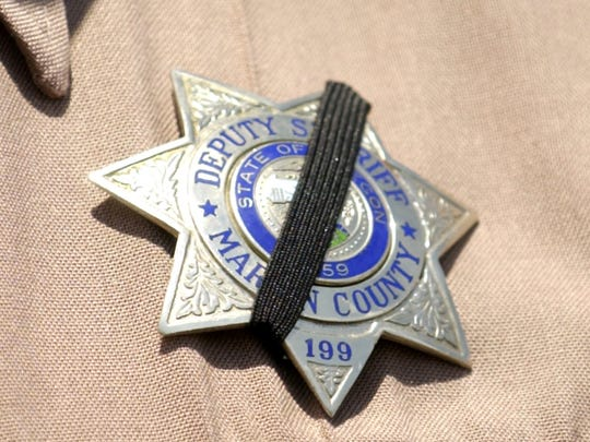 Law enforcement officers wear a black band over their